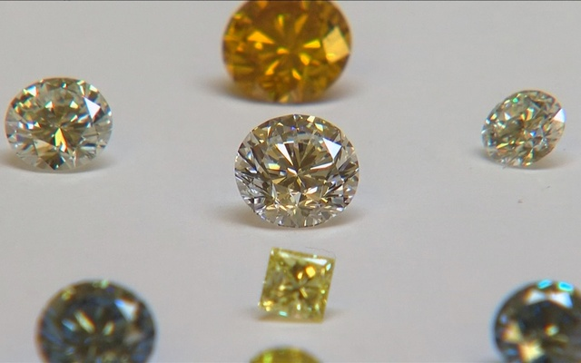 FILE PHOTO: A still image from video shows coloured synthetic diamonds on display at De Beers' International Institute of Diamond Grading and Research in Maidenhead August 15, 2016. Reuters
