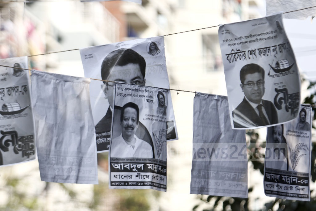Posters for the Awami League and BNP candidates in the Dhaka-10 parliamentary race hang in Dhanmondi. Photo: Mahmud Zaman Ovi
