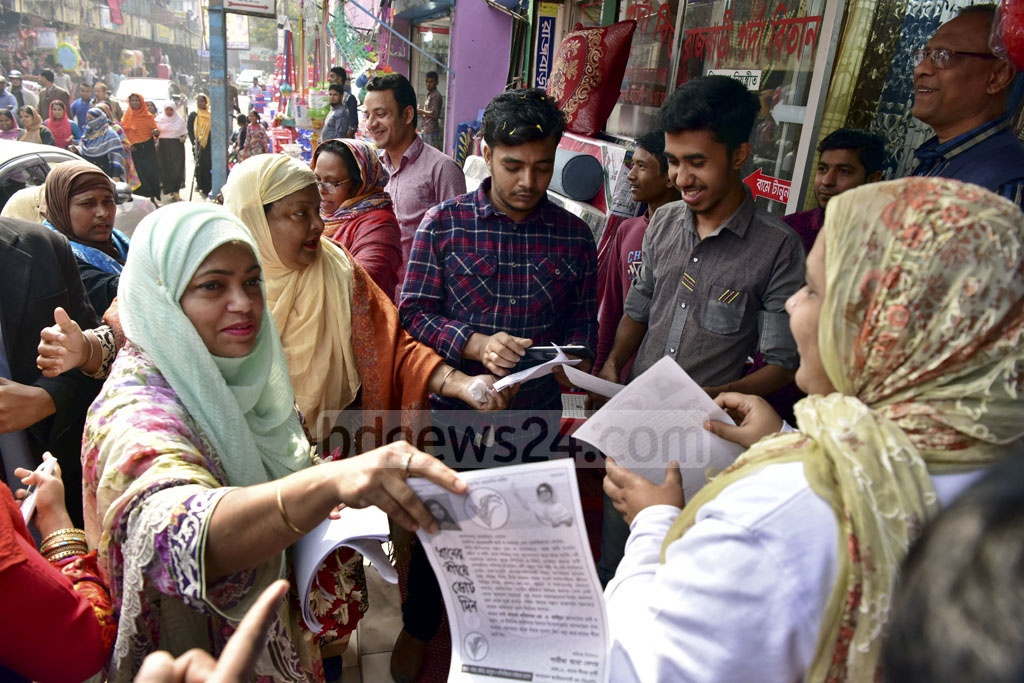 BNP candidate for Dhaka-11 Shamim Ara speaks to people in Khilgaon Taltala as part of her election campaign on Saturday.