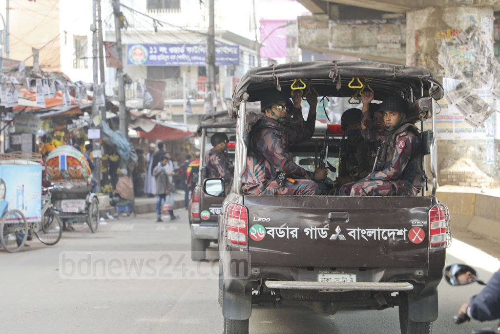 A total of 1,016 Border Guard Bangladesh platoons have been deployed across the country to act as law enforcers for the parliamentary election. This photo of BGB personnel patrolling Shahjahanpur in Dhaka was taken on Sunday afternoon.