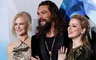 Cast members Jason Momoa, Nicole Kidman and Amber Heard pose at the premiere for