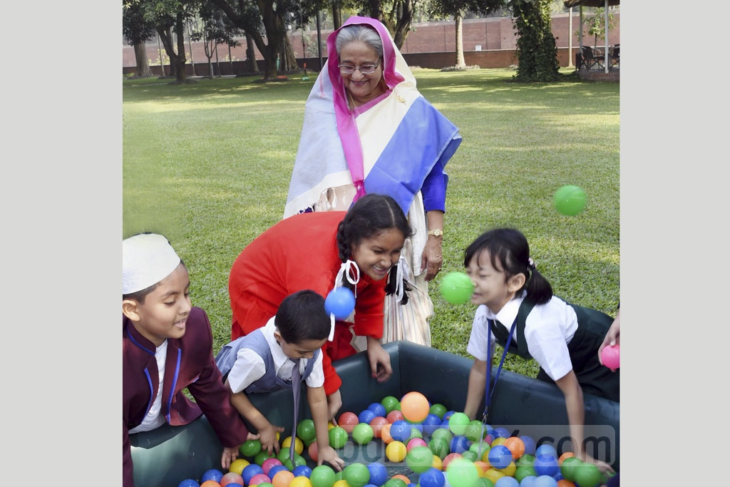 Prime Minister Sheikh Hasina spending time with children at the Ganabhaban in Dhaka after an event marking the publication of the results of PEC, JSC and equivalent exams and start of the free textbook distribution on Monday. Photo: PID