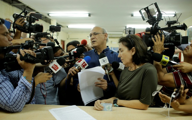 Journalist Carlos Fernando Chamorro, critic of the government of President Daniel Ortega, and his wife Desiree Elizondo arrive to the office of Attorney General of the Republic to file a trespassing complaint against the national police after his office was raided in Managua, Nicaragua Dec 19, 2018. REUTERS