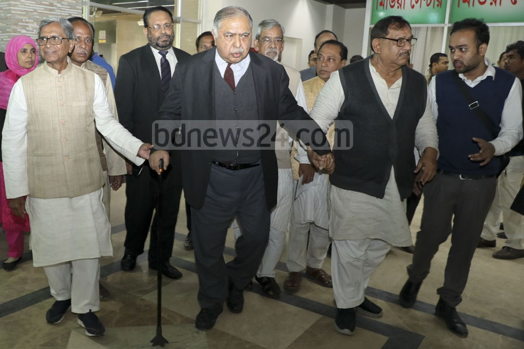 Jatiya Oikya Front leaders walking out of a meeting with the chief election commissioner on Tuesday.