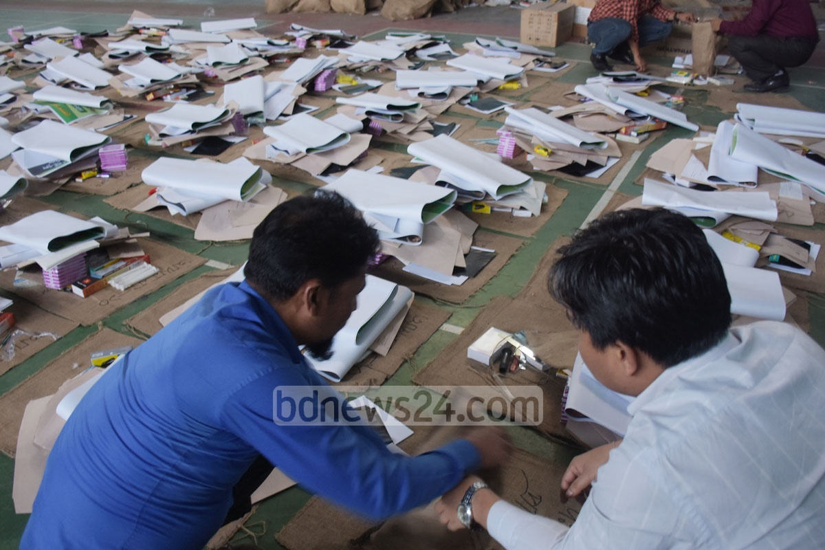 Officials sorting election materials for polling stations at Chattogram Gymnasium on Wednesday, four days before the general election. Photo: Suman Babu