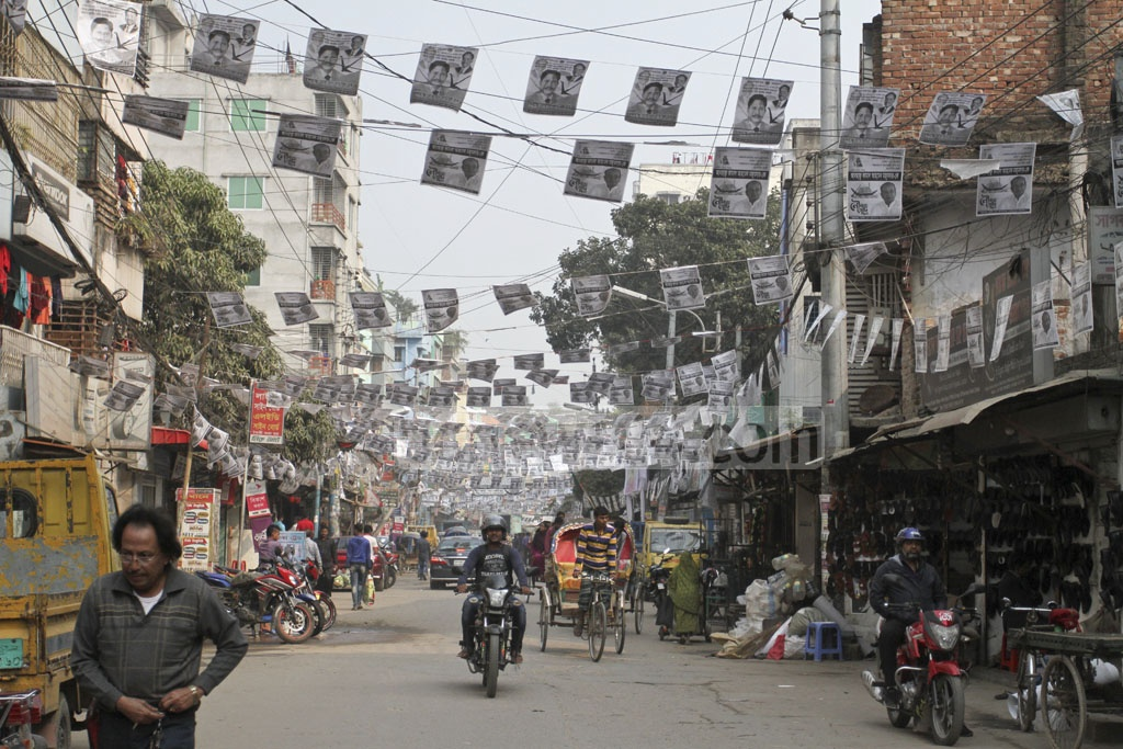 Election posters for the Dhaka-15 constituency cover the Mirpur-10 area on Wednesday. Photo: Asif Mahmud Ove