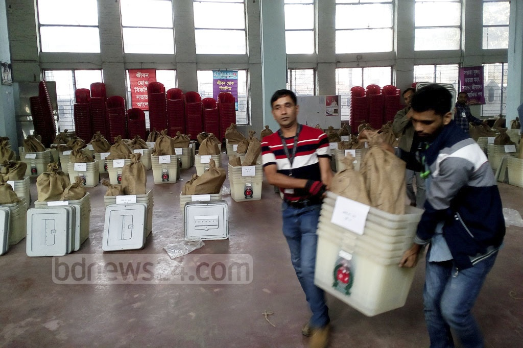 Voting materials are being taken to polling centres for the 11th national parliamentary election under heavy security. Voting materials for the Dhaka-8 polling centres were distributed from Willes Little Flower School on Saturday. Photo: Asif Mahmud Ove