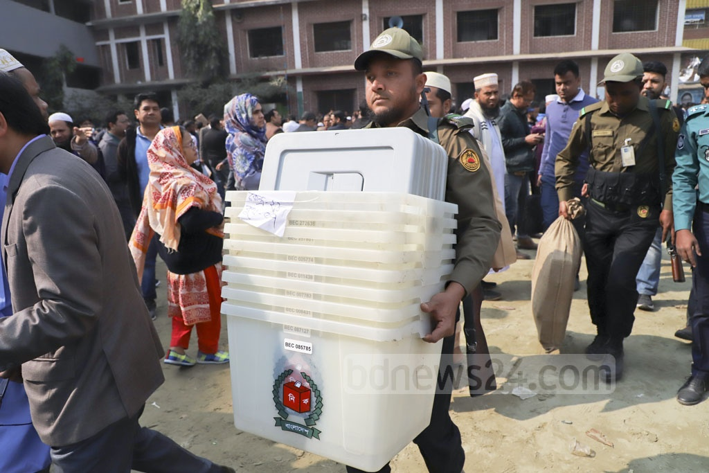 Voting materials for the Dhaka-4 and Dhaka-5 races were sent out under heavy security from Dhaka's Dolairpar High School on Saturday. Photo: Abdullah Al Momin