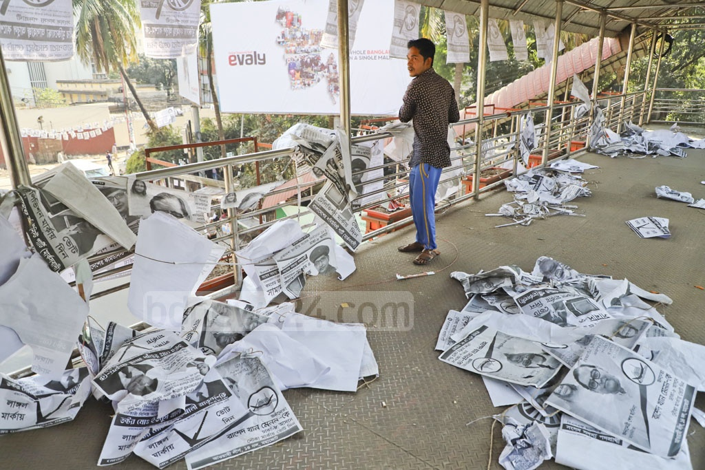Activists of various candidates were voluntarily removing election posters from Dhaka's Topkhana Road on Monday after the end of the 11th national parliamentary election. Photo: Abdullah Al Momin