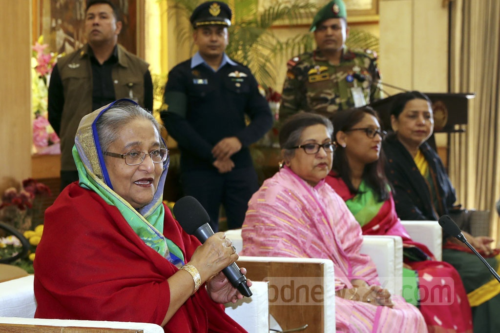 Awami League President and Prime Minister Sheikh Hasina speaks at the Ganabhaban after exchanging greetings with many congratulating her on her third consecutive election victory. Bangabandhu's younger daughter Sheikh Rehana and the prime minister's daughter Saima Wazed Hossain were also present at the Ganabhaban. Photo: Saiful Islam Kallol