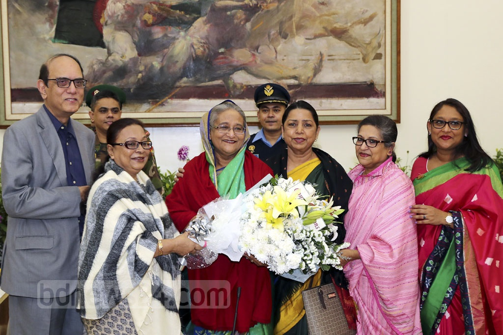 Political leaders, diplomats and civil and military officials congratulated Awami League President Sheikh Hasina with flowers on Monday after her party's landslide win in the 11th national parliamentary election. Bangabandhu's younger daughter Sheikh Rehana and the prime minister's daughter Saima Wazed Hossain were also present at the Ganabhaban. Photo: Saiful Islam Kallol
