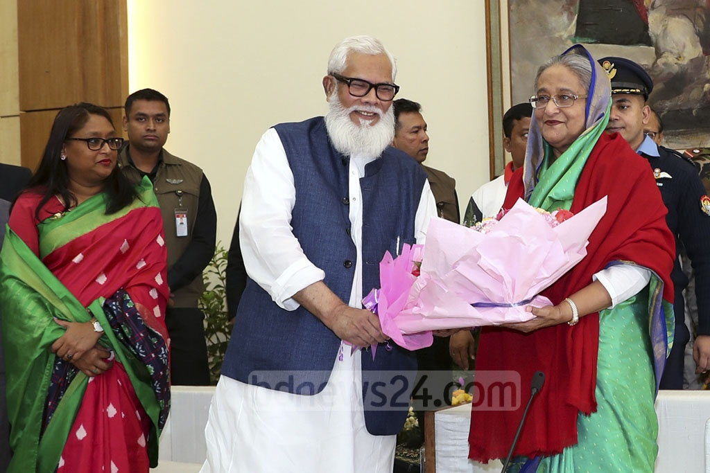 Newly elected Dhaka-1 MP businessman Salman F Rahman congratulates Prime Minister Sheikh Hasina with flowers after the Awami League's landslide victory in the 11th parliamentary election at the Ganabhaban on Monday. Photo: Saiful Islam Kallol