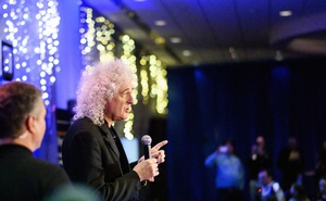 "Brian May, best known as the lead guitarist of the rock band Queen but also an astrophysicist collaborating with the mission's science team, speaks at Johns Hopkins University Applied Physics Laboratory in Laurel, Md., shortly after midnight on Tuesday morning, Jan. 1, 2019. May introduced a music video of a new song, ""New Horizons,"" which he wrote to celebrate the moment the NASA spacecraft New Horizons encountered Ultima Thule, an object orbiting one billion miles beyond Pluto. (Matt Roth/The New York Times)"