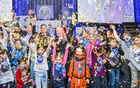 Alan Stern, centre, New Horizons' principal investigator, is surrounded by children at Johns Hopkins University Applied Physics Laboratory in Laurel, Md, shortly after midnight on Tuesday morning, Jan 1, 2019. They were celebrating the moment the NASA spacecraft New Horizons encountered Ultima Thule, an object orbiting one billion miles beyond Pluto. The New York Times