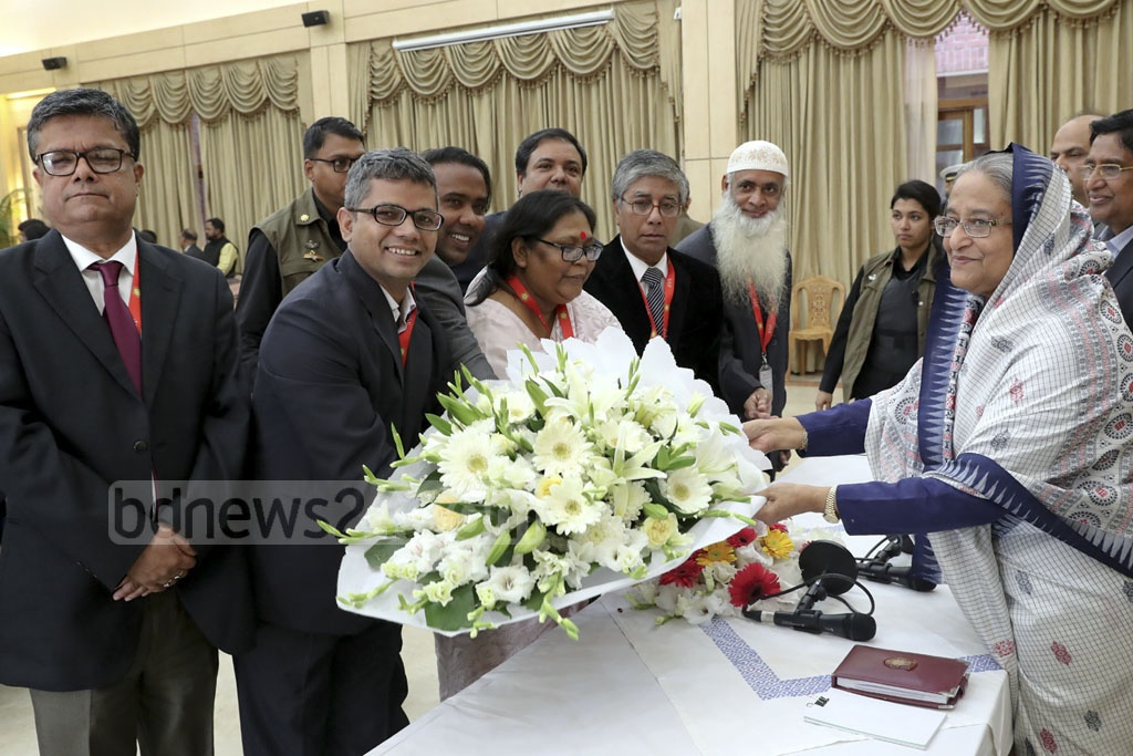 Different organisations, political leaders, diplomats, and civil and military officers greeted Sheikh Hasina with flowers at the Ganabhaban in Dhaka on Wednesday on her re-election as prime minister.