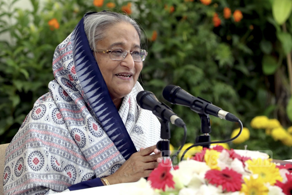 Awami League President Sheikh Hasina speaking at an event in Dhaka on Wednesday to exchange greetings on the party's landslide election win.