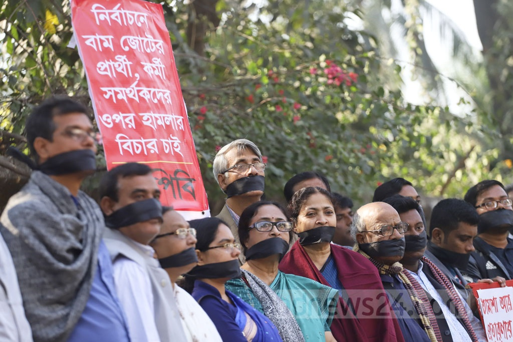 Members of the Left Democratic Alliance demonstrating outside the National Press Club in Dhaka on Thursday with their mouths wrapped in black clothes demanding cancellation of results of 11th parliamentary elections. Photo: Abdullah Al Momin