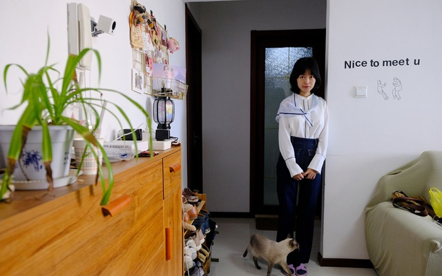 Zhou Xiaoxuan, 25, at her home in Beijing, Oct 17, 2018. She published an open letter on social media in July, in which she accused Zhu Jun, an anchor at China Central Television, the state-run broadcaster, of forcibly kissing and groping her while she worked as an intern at the station in 2014. Zhu Jun has denied the accusations, but Zhou Xiaoxuan has emerged as a hero of China's fledgling #MeToo movement. The New York Times