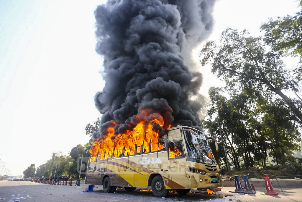 Garment workers set fire to a bus on Dhaka's Airport Road on Monday during a demonstration to demand an increase in the minimum wage and to press for a series of other demands. Photo: Mahmud Zaman Ovi