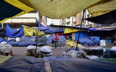 A man pedals his bicycle through a closed market during the strike called by All Assam Students Union (AASU) and the North East Students' Organisation (NESO) to protest against the government's bid to pass a bill in parliament to give citizenship to non-Muslims from neighbouring countries, in Guwahati, India January 8, 2019. Reuters