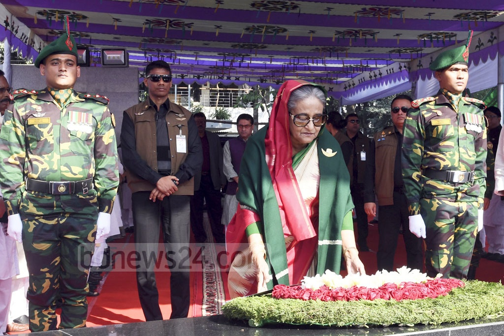 After beginning her record fourth term as prime minister, Sheikh Hasina pays tribute to her father Bangabandhu Sheikh Mujibur Rahman by placing a wreath in front of his portrait at Dhanmondi's Bangabandhu Memorial Museum on Tuesday. Photo: PID