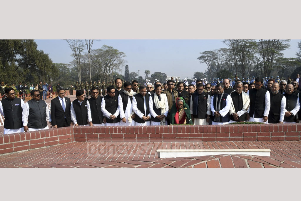 Cabinet members headed by Prime Minister Sheikh Hasina, who formed government for a third consecutive term, pays tribute to freedom fighters at Savar's National Martyrs' Memorial on Tuesday. Photo: PID