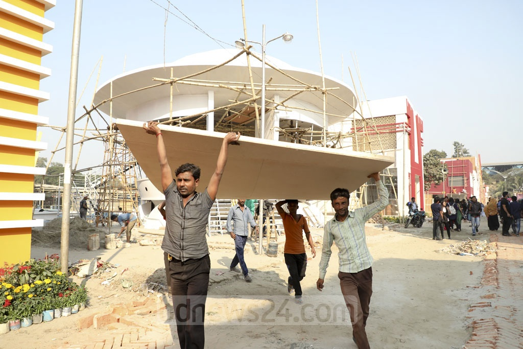 Workers preparing the venue for the month-long Dhaka International Trade Fair in Dhaka on Tuesday. Photo: Asif Mahmud Ove