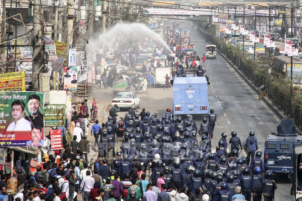Police using water-cannons to disperse agitating garment workers from the Dhaka-Aricha Highway at Savar's Karnapara.