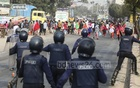 Police dispersing demonstrating readymade garment workers from the Dhaka-Aricha Highway at Savar's Karnapara.