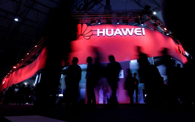 Visitors walk past Huawei's booth during Mobile World Congress in Barcelona, Spain, Feb 27, 2017. REUTERS