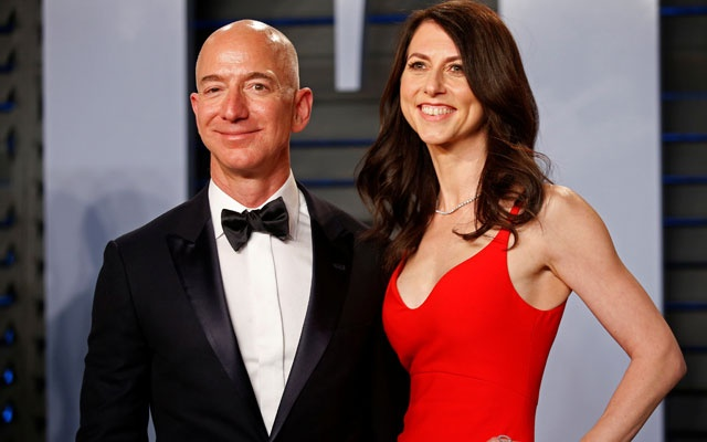 FILE PHOTO: Amazon CEO Jeff and wife MacKenzie Bezos arrive at the 2018 Vanity Fair Oscar Party in Beverly Hills, California. Reuters
