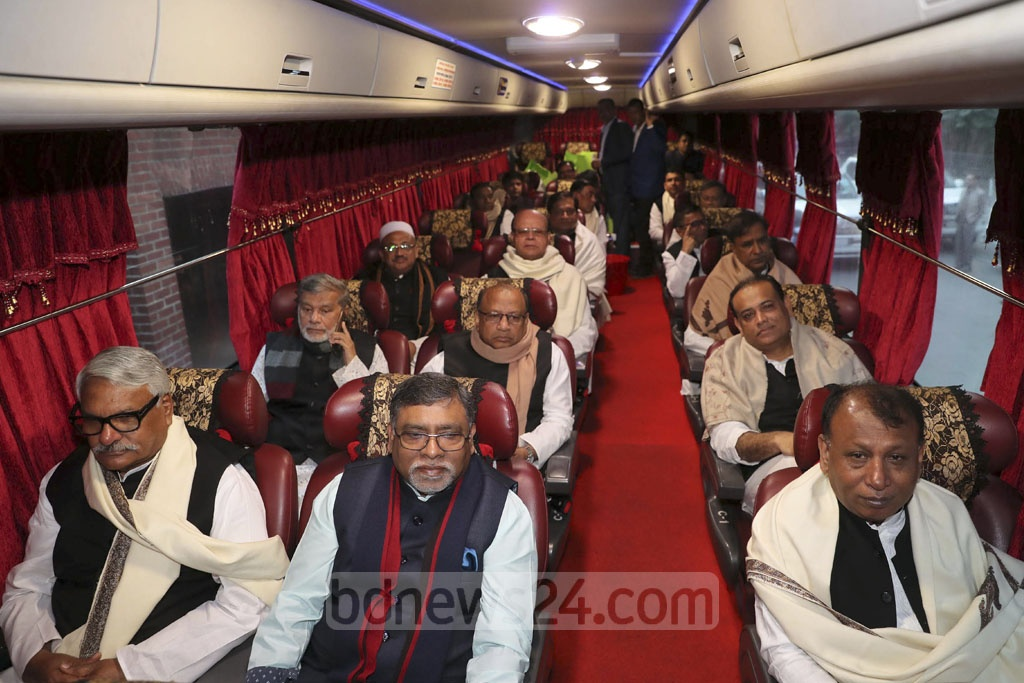Members of the new cabinet took a bus ride to Tungiparha, Gopalganj from Dhaka on Wednesday. Prime Minister Sheikh Hasina led them to pay tribute to Bangabandhu Sheikh Muhibur Rahman at his grave. Some MPs joined in. Photo: PID
