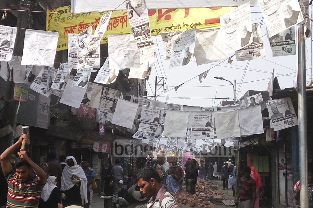 Election campaign posters hanging in the capital's Dholaipar area on Thursday, six days after a deadline set by Dhaka South Mayor Mohammad Sayeed Khokon for removal of the campaign posters, festoons and banners. . Photo: Abdullah Al Momin