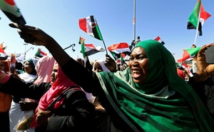 Supporters of Sudan's President Omar al-Bashir wave their national flags as they chant slogans to his favour during a rally at the Green Square in Khartoum, Sudan Jan 9, 2019. REUTERS