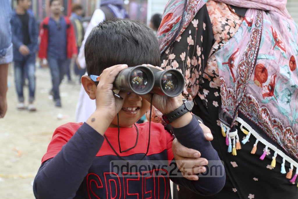 Children enjoying a visit to Dhaka International Trade Fair 2019 with their families on Friday. Photo: Asif Mahmud Ove
