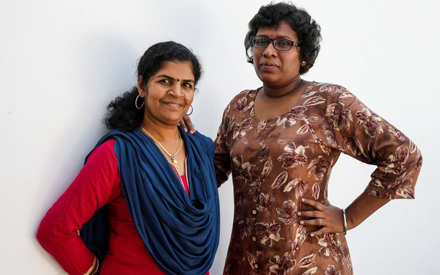 Kanaka Durga, 39 (L) and Bindu Ammini, 40, the first women to enter Sabarimala temple which traditionally bans the entry of women of menstrual age, pose for a photo after an interview with Reuters at an undisclosed location on the outskirts of Kochi, India, January 10, 2019. Reuters