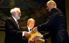 Michael Atiyah, centre, and Isadore Singer receive the Abel Award from Norway's King Harald in Oslo in 2004. The New York Times
