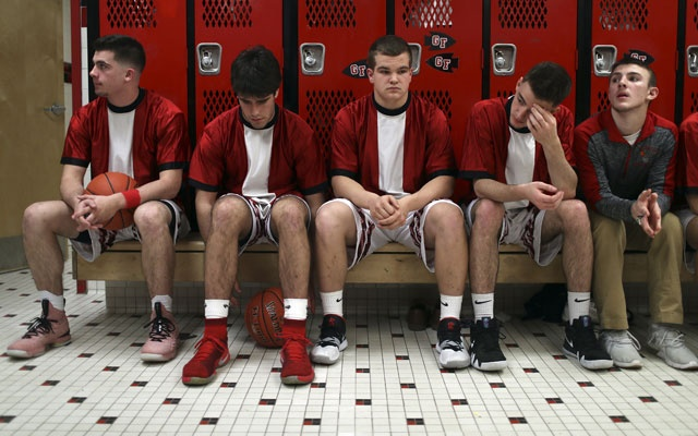 "High school basketball players before a game in Glens Falls, NY, Nov 30, 2018. The American Psychological Association approved its first set of official guidelines for working with boys and men. It posits that males who are socialised to conform to ""traditional masculinity ideology"" are often negatively affected in terms of mental and physical health. The New York Times"