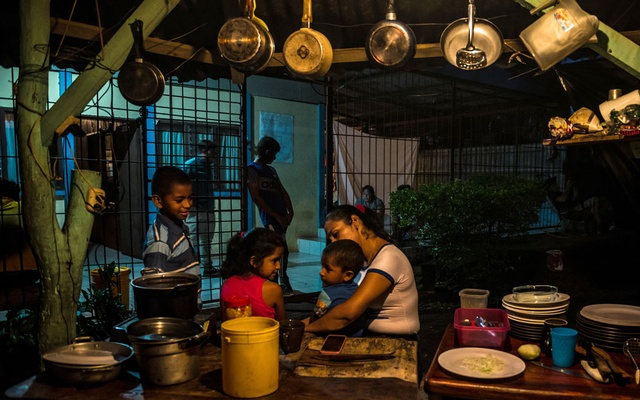 Lisseth Valdivia, who runs the refuge for anti-government protesters from Nicaragua, takes care of children living at the safe house in Costa Rica, Dec 20, 2018. The New York Times