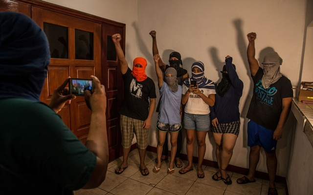 Anti-government dissidents, many wanted by Nicaraguan authorities, record a video message to post to social media at a safe house, Dec 19, 2018. The New York Times