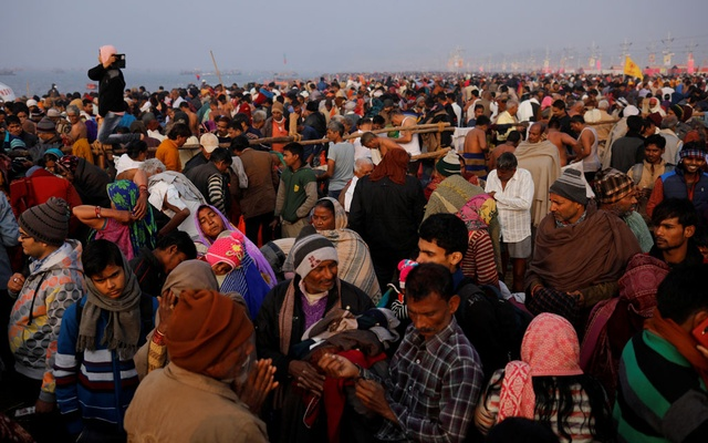 Devotees arrive to take a holy dip at Sangam, the confluence of the Ganges, Yamuna and Saraswati rivers, during