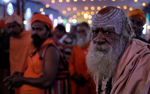 Sadhus or Hindu holy men participate in the evening prayers ahead of the