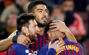 Barcelona's Luis Suarez celebrates scoring their third goal with Lionel Messi and Philippe Coutinho. Football - La Liga Santander - FC Barcelona v Eibar - Camp Nou, Barcelona, Spain - January 13, 2019. Reuters