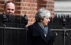 Britain's Prime Minister Theresa May leaves from the back of 10 Downing Street in London. REUTERS