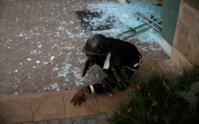 A member of security forces secures the scene where explosions and gunshots were heard at the Dusit hotel compound, in Nairobi, Kenya January 15, 2019. Reuters