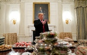US President Donald Trump speaks in front of fast food provided for the 2018 College Football Playoff National Champion Clemson Tigers due to the partial government shutdown in the State Dining Room of the White House. REUTERS