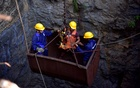 Divers use a pulley to enter a coal mine that collapsed in Ksan, in the northeastern state of Meghalaya, India, Dec 29, 2018. REUTERS