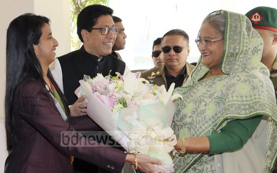 Prime Minister Sheikh Hasina is greeted with flowers upon her arrival at the public administration ministry on Thursday. Photo: PID