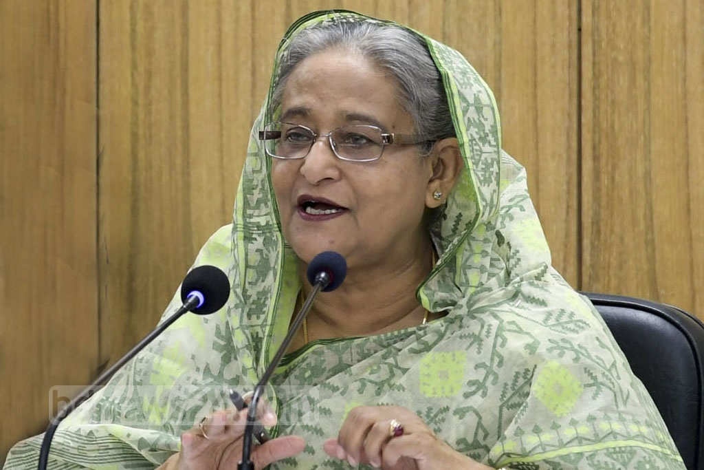 Prime Minister Sheikh Hasina interacts with officials of the public administration ministry at the Bangladesh secretariat on Thursday. Photo: PID