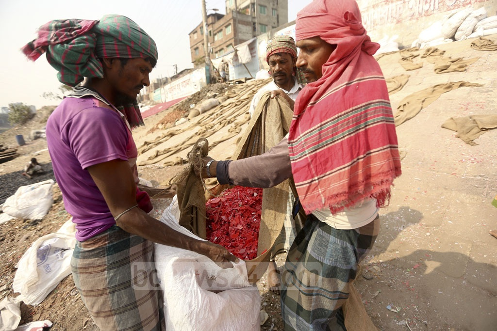 After drying up, the plastic pieces are placed in sacks which are taken to the recycling plant. Photo: Mahmud Zaman Ovi